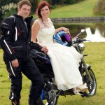 The happy couple pose on a bike