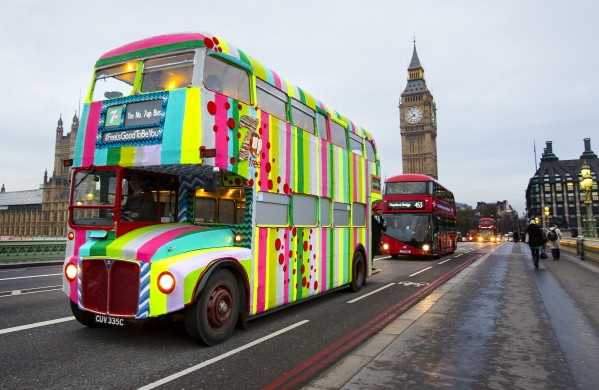 The iconic red London bus in its woolly coat