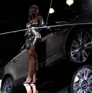 A model presents a Chrysler concept car during the media preview of the New York International Auto Show in 2010