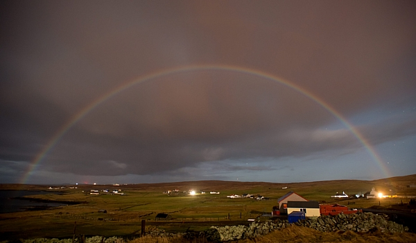 The rare moonbow arcs over the Shetland islands at midnight