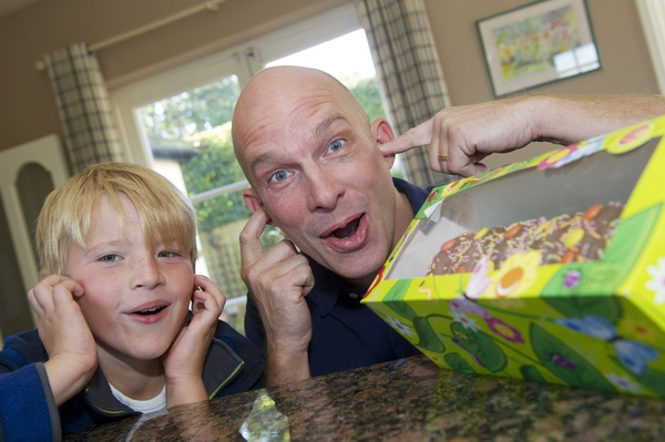 Julian Barrett, with son Freddie, nine, and the supermarket cake which triggered a positive result for explosives at Stansted Airport