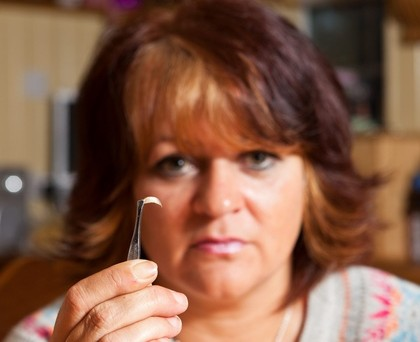 Tracy Arnold holds the human toenail she found in her pasta sauce from Aldi