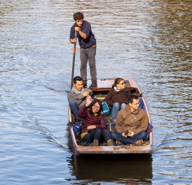 People enjoying a punt along the River Cam in Cambridge