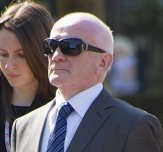 Former priest Malcolm McLennan, (centre, sunglasses) arrives at Maidstone Crown Court