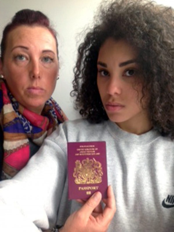 Sally Nayler with her daughter Shelby and the passport she travelled on