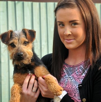 Megan Burton and pet dog Mylo who swallowed a fishing hook