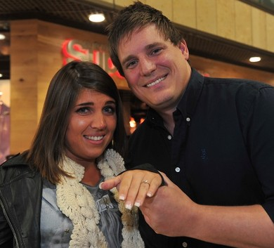 Phil Keene, 33, with his girlfriend Charlotte Ashworth, 25, after he proposed to her with a flash mob of 30 people