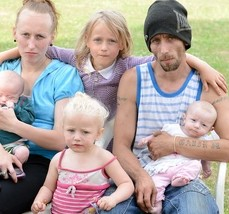 Maggie Flisher, 26, and husband Gavin, 30, and their kids. They get £30,000 a year in benefits