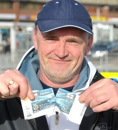 Disgruntled fan Ron Nixon from Coventry tears up his ticket as he arrives at Luton Airport after retuning from Poland