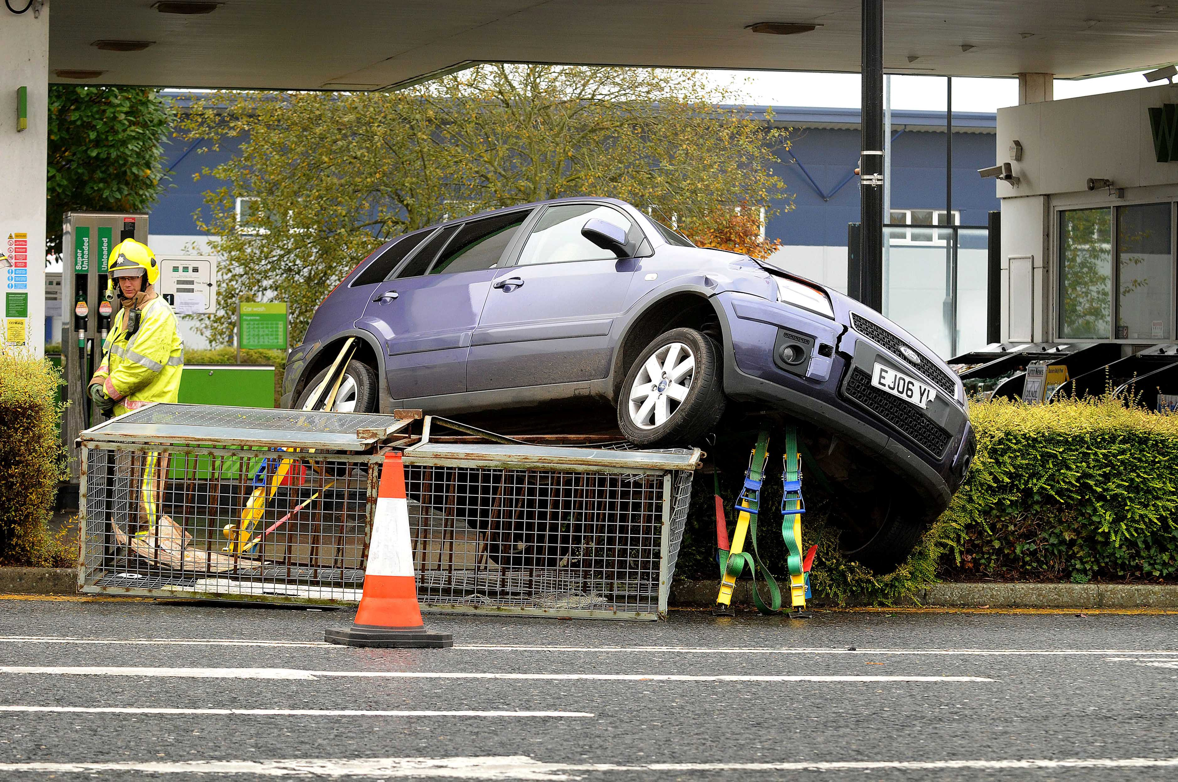 The pensioner's Ford Fusion car sits on top of gas containers at Waitrose in Kings Lynn, Norfolk