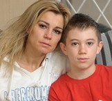 Maria Kosak with her son Ethan Kosak, 12, and his broken foot after he miraculously survived when a half-tonne gate fell on him and crushed his whole body