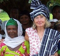 Lynne Symonds with village women in Gbenfu, northern Ghana, where she is the head of three tribes