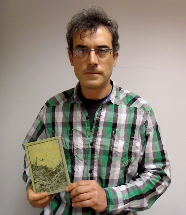 Inaki Buenaposada with one of the books which he took from his host family when he was staying in Cambridge 25 years ago