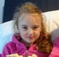 Millie Gore, five, (left) with her sister Faith, six, in Pembury Hospital moments before she fell ill after smelling hand sanitiser