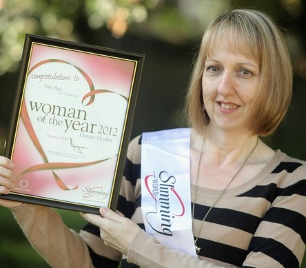 Breast cancer survivor Julie Hart with her woman of the year award