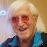 Sir Jimmy Savile outside the cafe named Jimmys in the National Spinal Injuries Centre at Stoke Mandville Hospital in November 2005