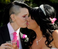 The couple share a kiss after getting hitched