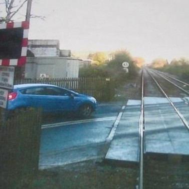 This is the shocking view of a panicked train driver just seconds from a collision after a reckless motorist ignored a level crossing barrier