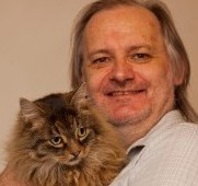 Steve Allan, 54, with his cat, Milo, 10, who went missing almost eight-years-ago and has just been found