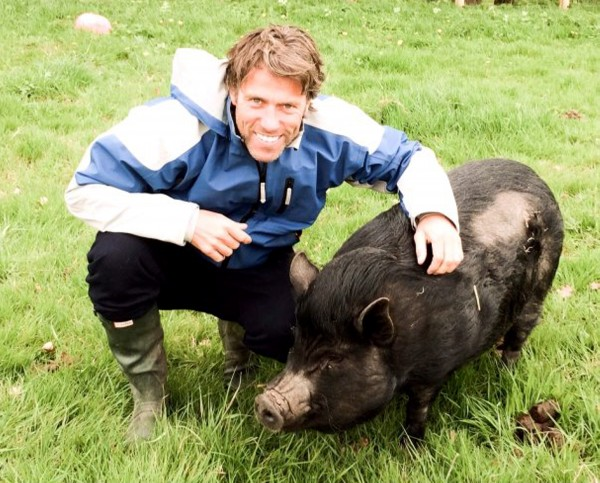 "Comedian John Bishop has adopted this rescued pig after his wife saw a video of it online and ""fell in love"""