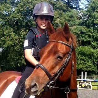 Josh Kindell riding his pony Tango