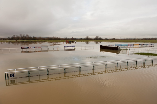 The River Ouse in Cambridgeshire floods Huntingdon Racecourse, close to where pensioner died after his car was swept away in the torrential rain