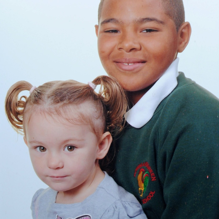 Sonny Lewis-Failla with his white sister Gina. He was told he must work harder in life because he is black
