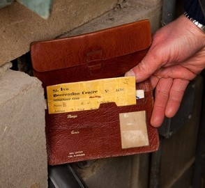 Richard Lane's wallet next to the wall cavity it is believed to have been thrown inside 35 years ago