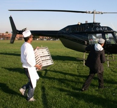 Abul and his staff load the takeaway onto a helicopter bound for Paris