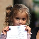 Caidence Leadbitter with her Mother Kelly Johnson and the letter threatening her with an ASBO