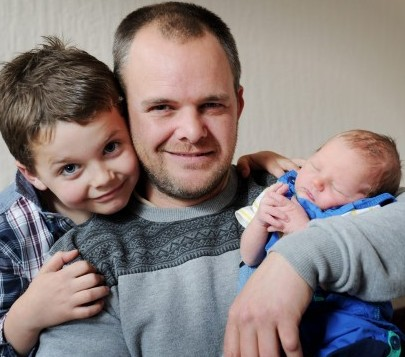 Rob Keeling with the two sons that he delivered - baby Archy and Bobby