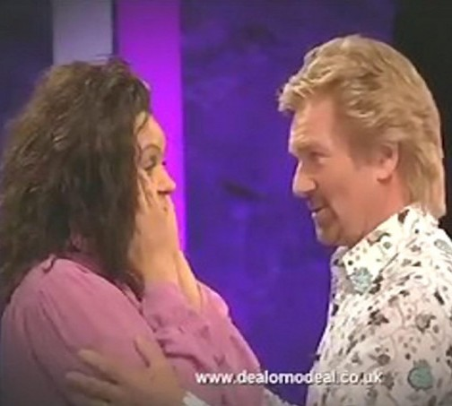 Caroline Banana celebrates with Noel Edmonds after winning Deal or No Deal but she has now been charged with benefit fraud