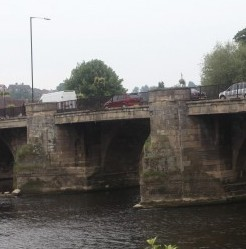 Killjoy council chiefs have removed dozens of floral hanging baskets from this historic bridge because of HEALTH and SAFETY fears