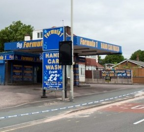 The Formula 1 car wash in Quarry Bank, Birmingham where a man was hit and killed by a lorry after being chased out into the road