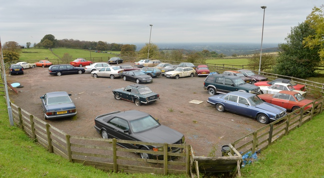 The car park full of 105 classic cars abandoned by the previous tenant. They will now be auctioned