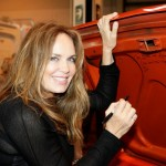 Catherine signs an orange car similar to the one that was used in the cult classic Dukes of Hazzard