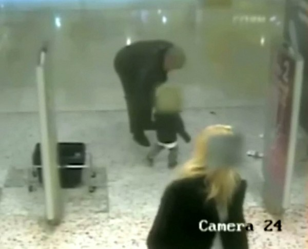 CCTV captures the moment the pensioner takes the boy's hand while his mother looks away