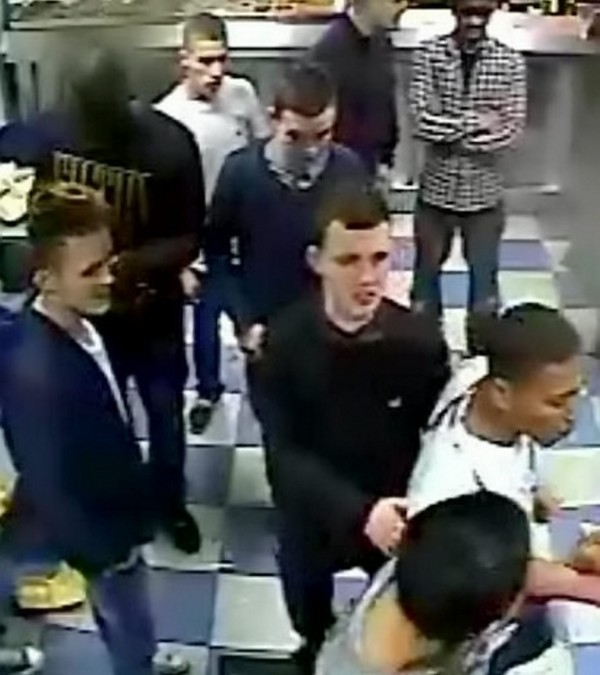 The moment a gang attacked a teenager in a row over a bag of chips