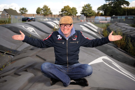 Thrilled Chris Evans celebrates after winning the iconic Dunlop Bridge in an auction for just £250