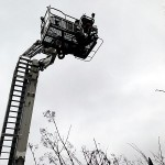 Firemen go up in a cherry picker to try and retrieve Georgie