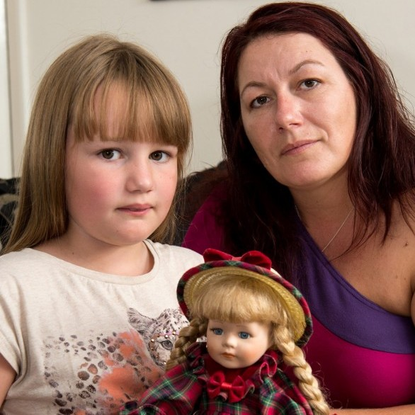 Katie Hyde with her daughter Grace who is waiting for the results of an AIDS test after she pricked her finger on a syringe hidden inside a doll