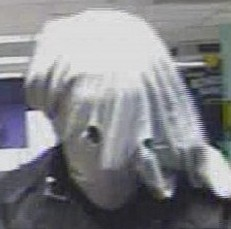 CCTV still of the masked robber wearing a mask like that of the Elephant Man