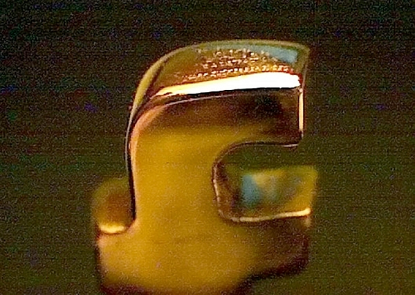 The gold letter F which is just 3mm tall