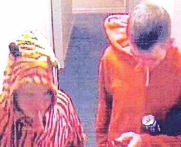 CCTV captures Fred Dixon dressed as a Tiger and David Aston-Brown as a Red Devil on the night of the attack