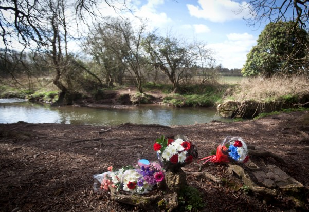 Floral tributes lie at the location on the River Arrow, near Redditch in Worcestershire, where yesterday Richard Fellows died