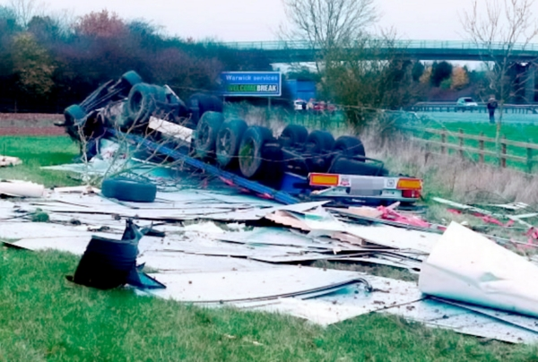 The aftermath of the crash in which the lorry flipped over