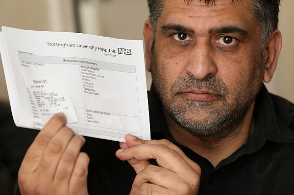 Nasar Malik with the parking charges he incurred after going to hospital with a suspected heart attack
