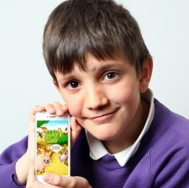 Lee Walters, aged 10, with the iPhone he used to rack up a £600 bill playing the game Hay Day
