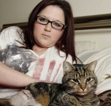 Jodie Robertson with Bobbie the cat, whose leg was shattered into pieces by a pellet gun