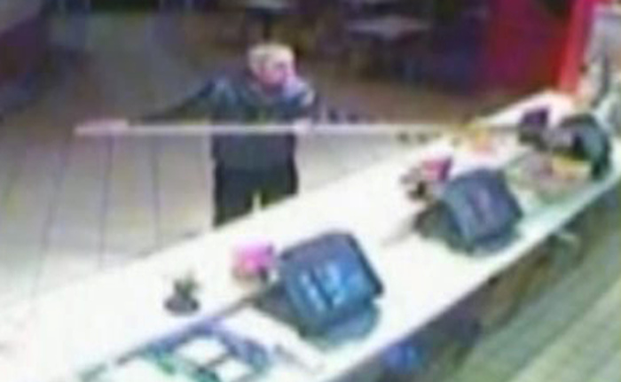 Brown wields a metal scaffolding pole over the counter after being refused a bargain bucket